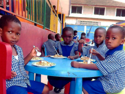Ghana-West-Africa-children-kids-eating-at-blue-table